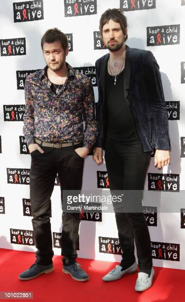 Musician's Tom Meighan and Sergio Pizzorno of Kasabian attend the Keep A Child Alive Black Ball fundraiser on May 27 2010 in London England