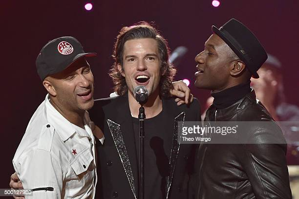 Musicians Tom Morello Brandon Flowers and Aloe Blacc perform on stage during the Imagine John Lennon 75th Birthday Concert at The Theater at Madison...