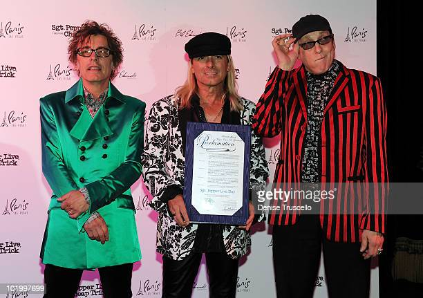 Musicians Tom Peterson Robin Zander and Rick Nielsen of Cheap Trick pose for photos at Paris Las Vegas on June 11 2010 in Las Vegas Nevada