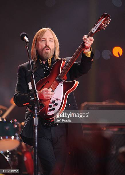 Musicians Tom Petty The Heartbreakers perform during the 'Bridgestone Halftime Show' at Super Bowl XLII between the New York Giants and the New...