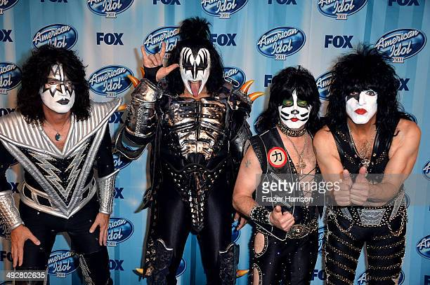 Musicians Tommy Thayer Gene Simmons Eric Singer and Paul Stanley of Kiss pose in the press room during Fox's American Idol XIII Finale at Nokia...