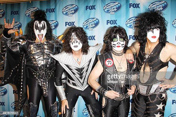 Musicians Tommy Thayer Gene Simmons Eric Singer and Paul Stanley of KISS pose in the press room during Fox's American Idol XIII Finale held at Nokia...