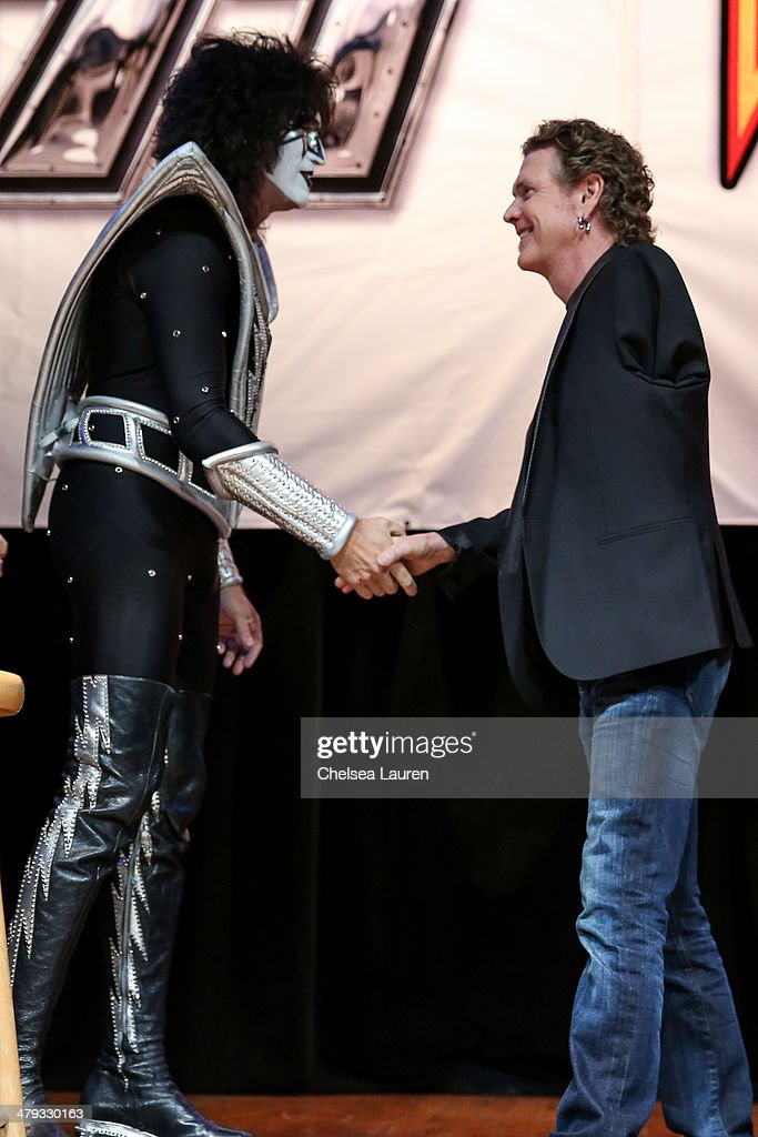 Musicians Tommy Thayer of KISS (L) and Rick Allen of Def Leppard appear at a press conference to announce the KISS and Def Leppard '2014 Heroes Tour' at House of Blues on March 17, 2014 in West Hollywood, California.