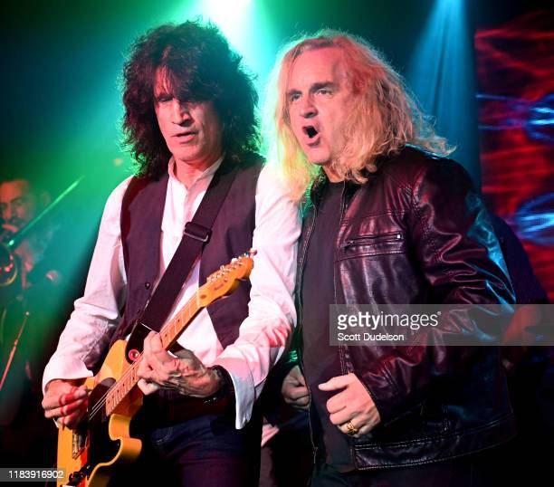 Musicians Tommy Thayer of the band KISS and Jason Scheff of Chicago perform onstage during the 2019 Medlock Krieger All Star welcome concert...