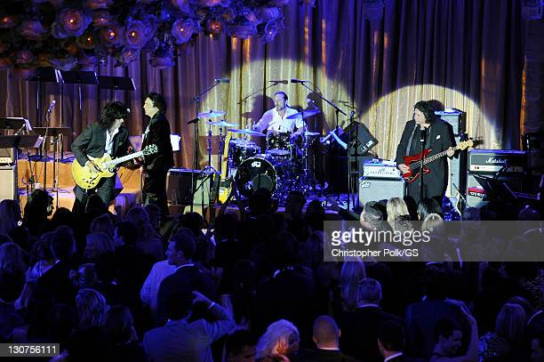 Musicians Tommy Thayer Paul Stanley Eric Singer and Gene Simmons of the band KISS perform onstage at the wedding of Gene Simmons and Shannon Tweed at...