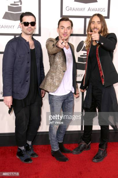 Musicians Tomo Milicevic Shannon Leto and Jared Leto of Thirty Seconds To Mars attend the 56th GRAMMY Awards at Staples Center on January 26 2014 in...