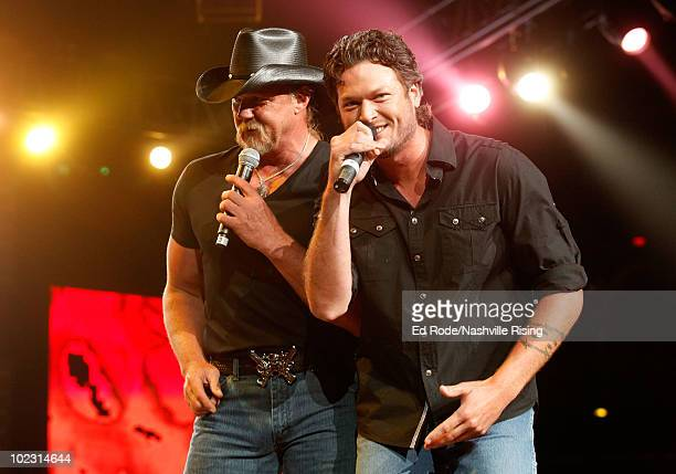 Musicians Trace Adkins and Blake Shelton perform onstage at Nashville Rising a benefit concert for flood relief at Bridgestone Arena on June 22 2010...