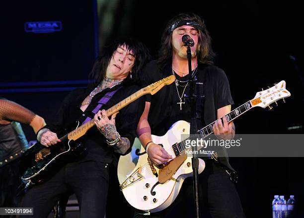 """Musicians Trace Cyrus and Mason Musso of Metro Station perform before the Miley Cyrus """"Wonder World"""" tour at Staples Center on September 22, 2009 in..."""