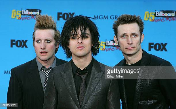Musicians Tre Cool Billie Joe Armstrong and Mike Dirnt of Green Day arrive at the 2005 Billboard Music Awards held at the MGM Grand Garden Arena on...