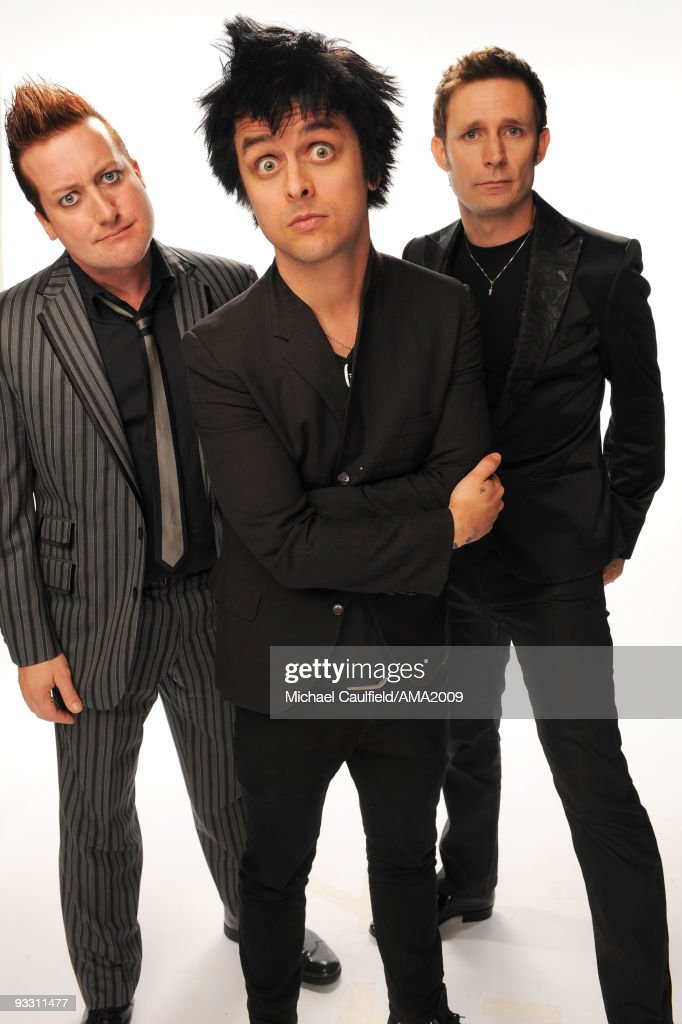 Musicians Tre Cool, Billie Joe Armstrong and Mike Dirnt of Green Day pose for a portrait at the 2009 American Music Awards at Nokia Theatre L.A. Live on November 22, 2009 in Los Angeles, California.