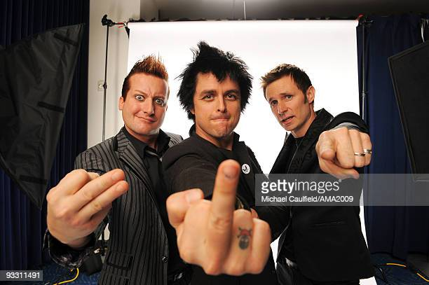 Musicians Tre Cool Billie Joe Armstrong and Mike Dirnt of Green Day pose for a portrait at the 2009 American Music Awards at Nokia Theatre LA Live on...
