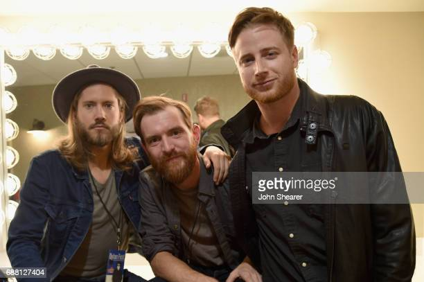 Musicians Trevor Terndrup Tommy Putnam and Wes Bailey of musical group Moon Taxi take photos backstage at the Dylan Fest at Ryman Auditorium on May...