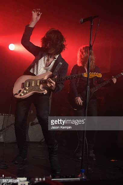 Musicians Tyler Bryant and Noah Denney of Tyler Bryant The Shakedown perform onstage during the John Varvatos Spring/Summer 2017 Fashion Show after...
