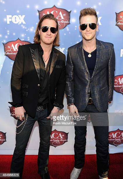 Musicians Tyler Hubbard and Brian Kelley of Florida Georgia Line arrive at the American Country Awards 2013 at the Mandalay Bay Events Center on...