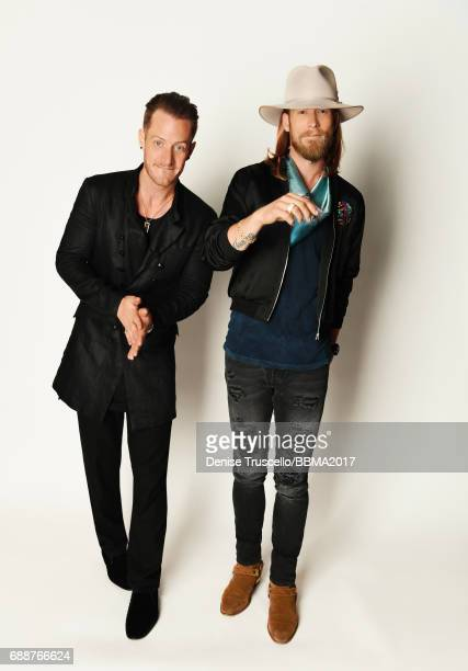 Musicians Tyler Hubbard and Brian Kelley of Florida Georgia Line pose for a portrait during the 2017 Billboard Music Awards at TMobile Arena on May...