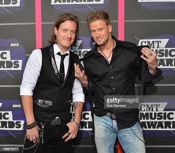 Musicians Tyler Hubbard and Brian Kelley of Florida Georgia Line attend the 2013 CMT Music awards at the Bridgestone Arena on June 5 2013 in...