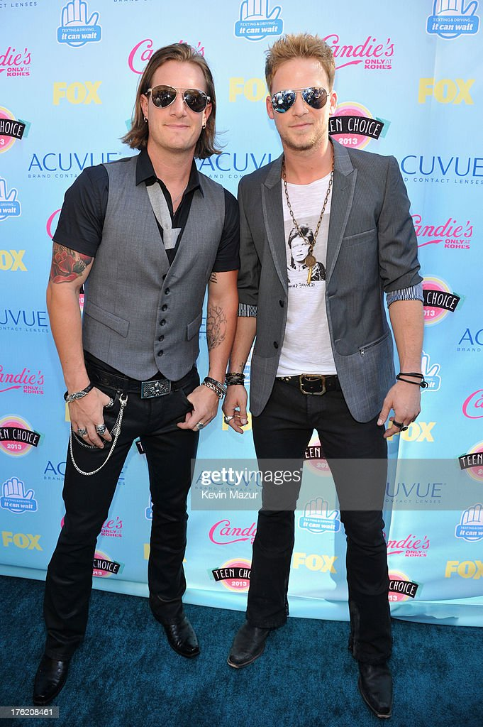 Musicians Tyler Hubbard (L) and Brian Kelley of Florida Georgia Line attend the 2013 Teen Choice Awards at Gibson Amphitheatre on August 11, 2013 in Universal City, California.