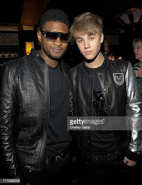 Musicians Usher and Justin Bieber attend Scott 'Scooter' Braun's 30th Birthday Party at the Music Box Theater on June 18 2011 in Hollywood California