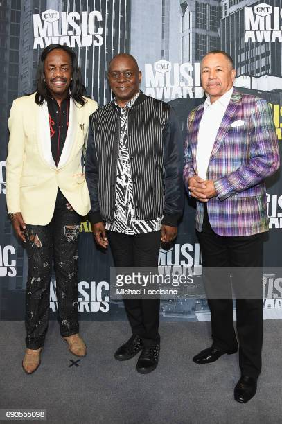 Musicians Verdine White Philip Bailey Jr Ralph Johnson of musical group Earth Wind Fire attend the 2017 CMT Music Awards at the Music City Center on...