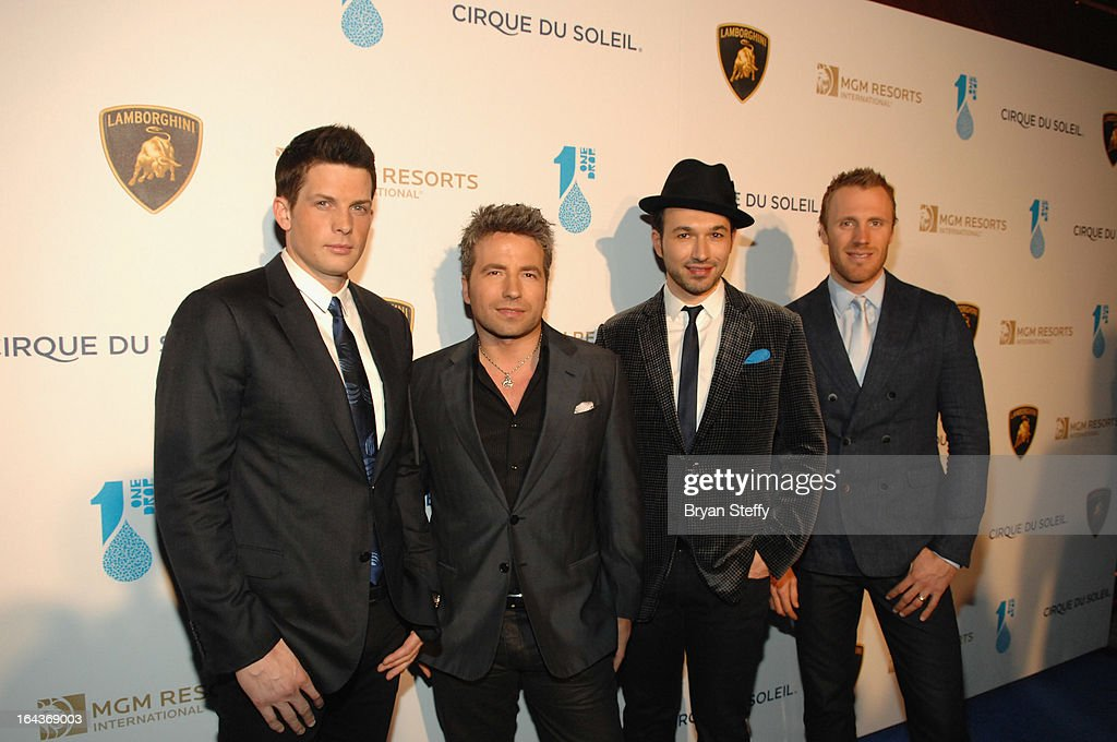 Musicians Victor Micallef, Remigio Pereira, Clifton Murray and Fraser Walters of the Canadian Tenors arrive at Cirque du Soleil's 'One Night for ONE DROP' at Hyde Bellagio at the Bellagio on March 22, 2013 in Las Vegas, Nevada.