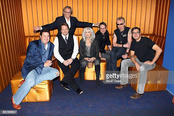Musicians Vince Gill Jerry Douglas Museum director Kyle Young Emmylou Harris JD Andrew Billy Bob Thornton and Mike Butler pose for a photo at the...
