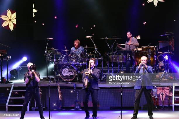 Musicians Walfredo Reyes, Daniel De la Reyes, James Pankow, Ray Herrmann and Lee Loughnane of the classic rock band Chicago perform onstage at the...