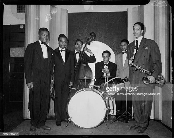 Musicians Walt Harper Calvin Folks holding trumpet Ray Brown on bass Chuck Johnson on drums Sonny Morgan and Bradley Bluett on saxophone in Harris...