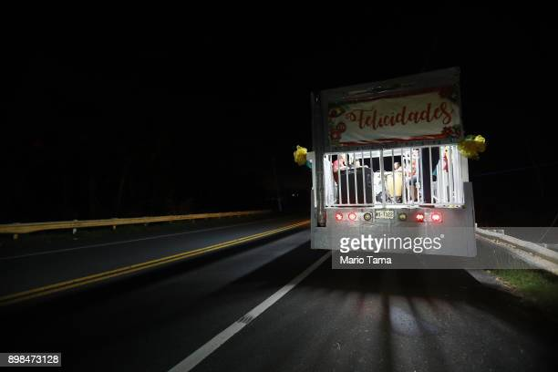 Musicians warm up playing parrandas a Puerto Rican tradition similar to Christmas carols along a darkened street on Christmas Eve on December 24 2017...