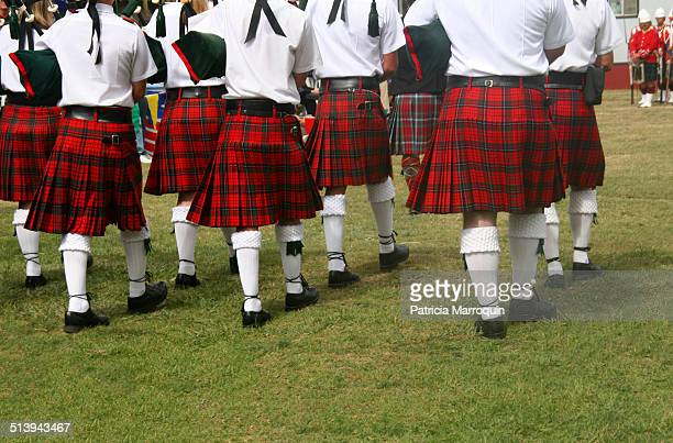 Musicians wearing redplaid kilts march at the Seaside Highland Games in Ventura California Scottish culture is celebrated at this 3day event created...