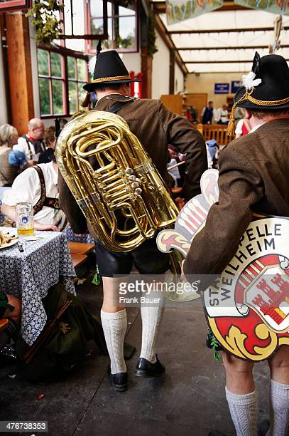 Musicians wearing traditional Bavarian attire in a beer tent at the Oktoberfest on September 19 2010 in Munich Germany