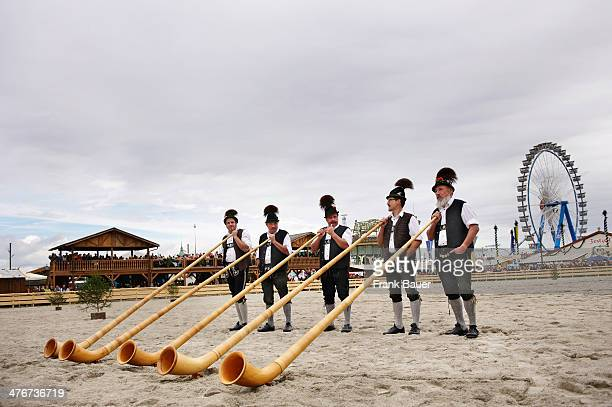 Musicians wearing traditional Bavarian attire with Alpenhorn at the Oktoberfest on September 17 2010 in Munich Germany