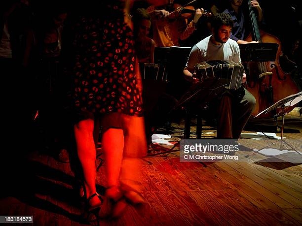 CONTENT] Musicians were playing live music in a popular Argentine Tango bar La Cathedral amateur dancers were dancing around them
