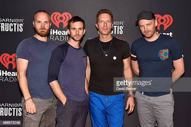 Musicians Will Champion Guy Berryman Chris Martin and Jonny Buckland of Coldplay attend the 2015 iHeartRadio Music Festival at MGM Grand Garden Arena...