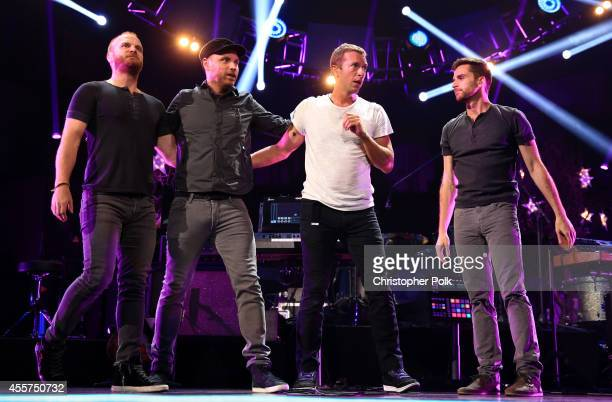 Musicians Will Champion Jonny Buckland Chris Martin and Guy Berryman of Coldplay perform onstage during the 2014 iHeartRadio Music Festival at the...