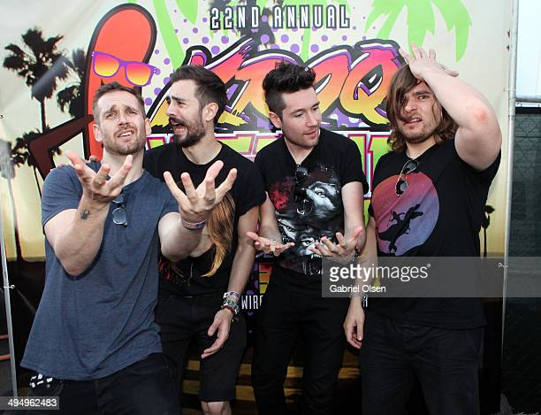 Musicians Will Farquarson Kyle Simmons Dan Smith and Chris Woody Wood of Bastille pose backstage during the 22nd Annual KROQ Weenie Roast at Verizon...