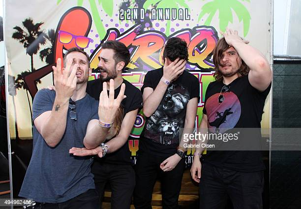 Musicians Will Farquarson Kyle Simmons Dan Smith and Chris 'Woody' Wood of Bastille pose backstage during the 22nd Annual KROQ Weenie Roast at...