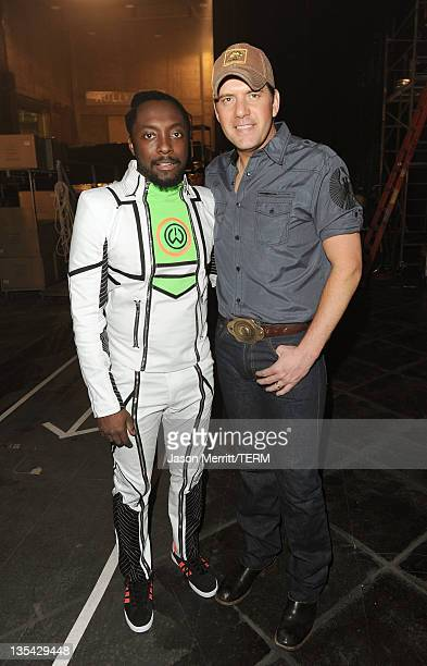 Musicians Will.I.am and Rodney Atkins attend the American Giving Awards presented by Chase held at the Dorothy Chandler Pavilion on December 9, 2011...