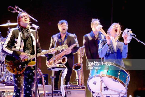 Musicians Win Butler and Richard Parry of Arcade Fire perform onstage during day 3 of the 2014 Coachella Valley Music Arts Festival at the Empire...