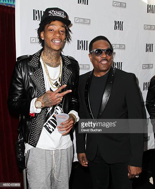 Musicians Wiz Khalifa and Charlie Wilson attend the BMI Presents Annual How I Wrote That Song PreGrammy Event at House of Blues Sunset Strip on...