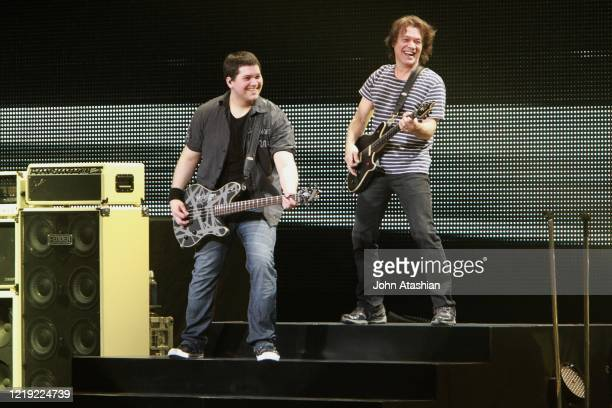"""Musicians Wolfgang and Eddie Van Halen are shown performing on stage during a """"live"""" concert appearance with Van Halen on March 3, 2012. """"n"""
