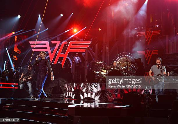 Musicians Wolfgang Van Halen David Lee Roth Alex Van Halen and Eddie Van Halen of Van Halen perform onstage during the 2015 Billboard Music Awards at...