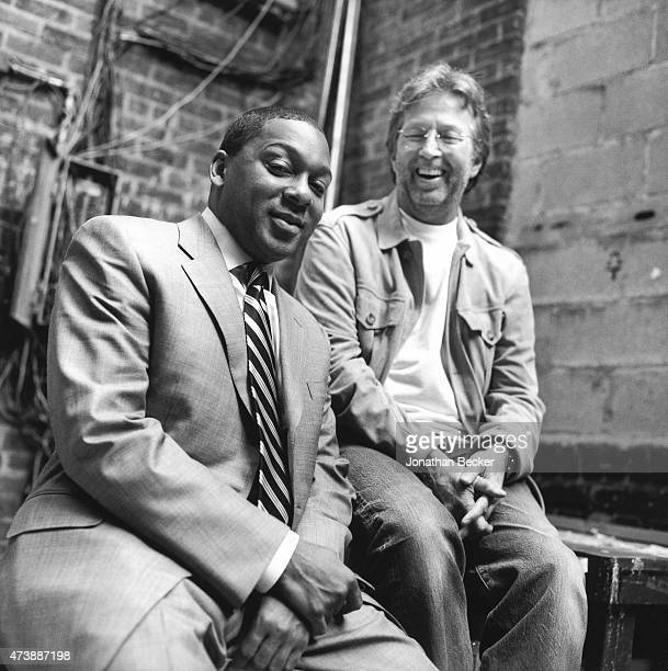 Musicians Wynton Marsalis and Eric Clapton are photographed for Vanity Fair Magazine on June 2, 2003 in the back alley of the Apollo Theater in...
