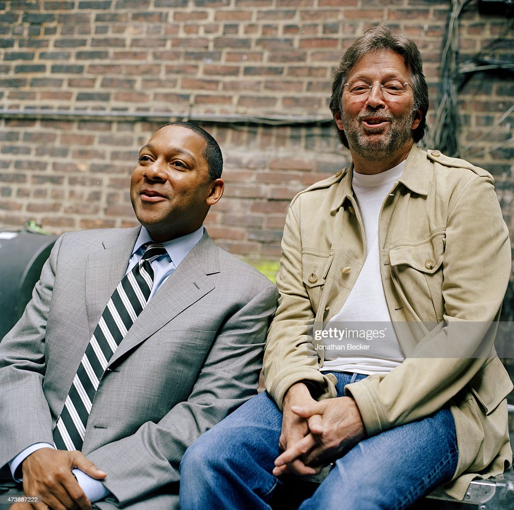 Musicians Wynton Marsalis and Eric Clapton are photographed for Vanity Fair Magazine on June 2, 2003 in the back alley of the Apollo Theater in Harlem, New York.