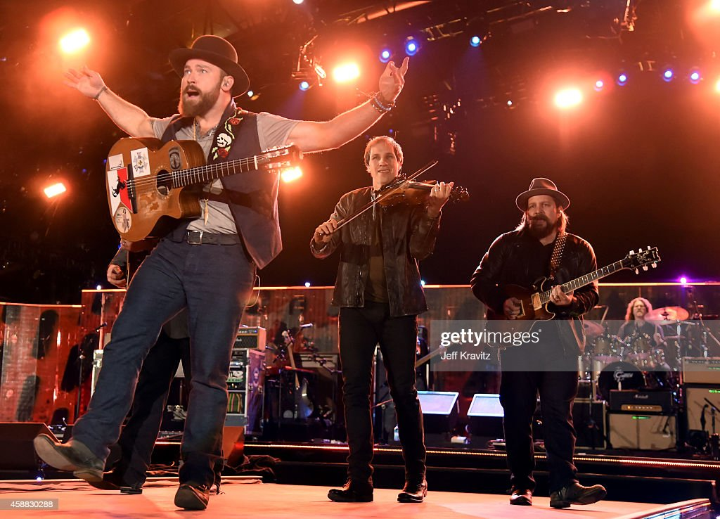 Musicians Zac Brown, Jimmy De Martini and Coy Bowles of Zac Brown Band perform onstage during 'The Concert For Valor' at The National Mall on November 11, 2014 in Washington, DC.