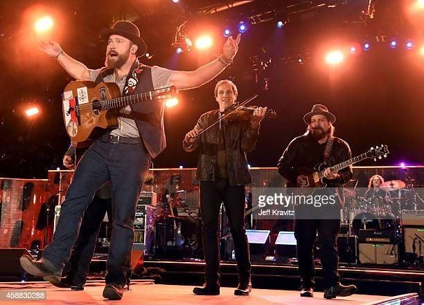 Musicians Zac Brown Jimmy De Martini and Coy Bowles of Zac Brown Band perform onstage during 'The Concert For Valor' at The National Mall on November...