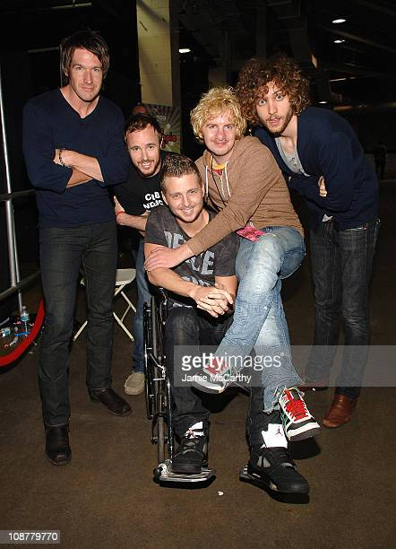Musicians Zach Filkins Eddie Fisher Ryan Tedder Drew Brown and Brent Kutzle of One Republic pose backstage during Z100's Zootopia at the IZOD Center...