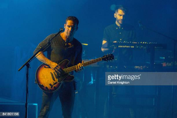 Musicians Zack Filkins and Brian Willett of OneRepublic perform on stage at Mattress Firm Amphitheatre on September 1 2017 in Chula Vista California