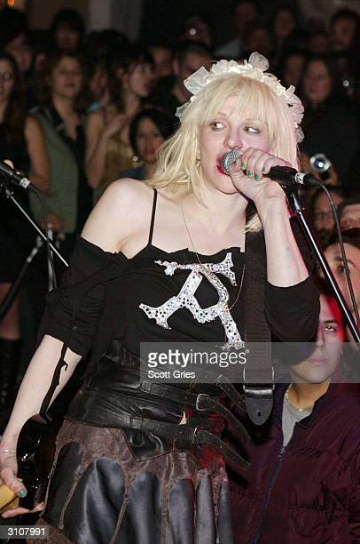 Musician/Singer Courtney Love performs at Plaid on March 17 2004 in New York City Love was arrested for reckless endangerment in the early morning...