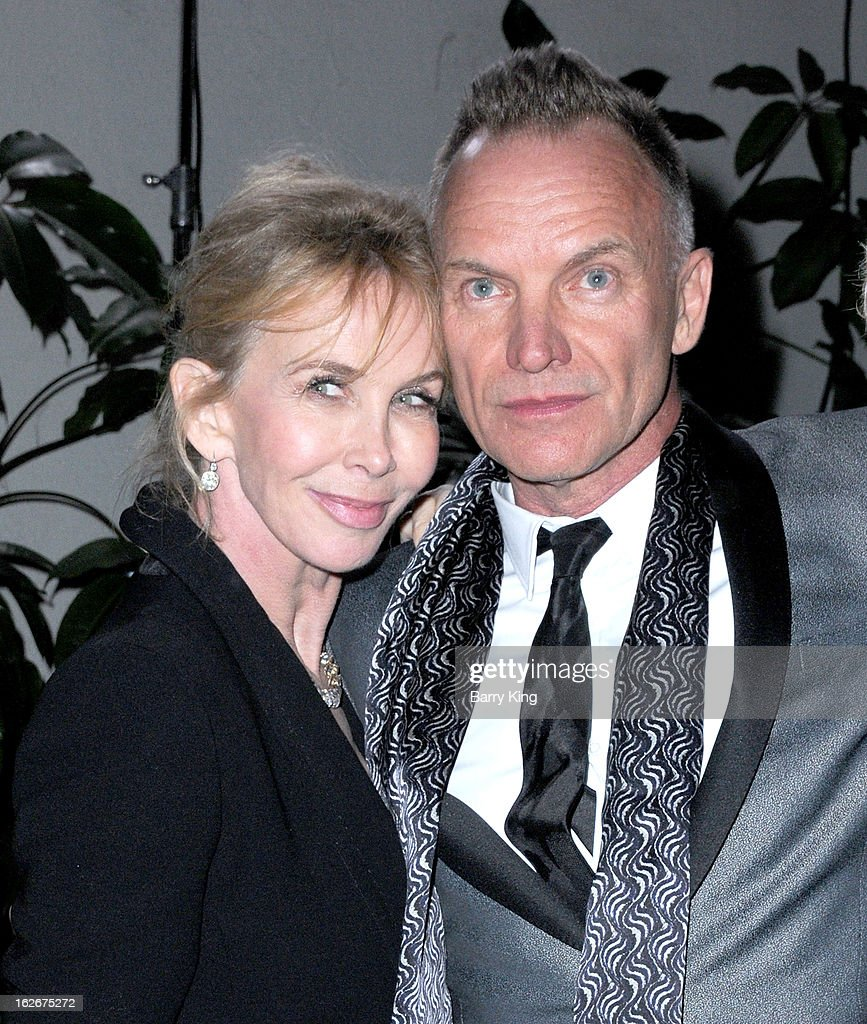 Musician/singer Sting (R) and Trudie Styler attend the Warner Music Group 2013 Grammy celebration at Chateau Marmont on February 10, 2013 in Los Angeles, California.