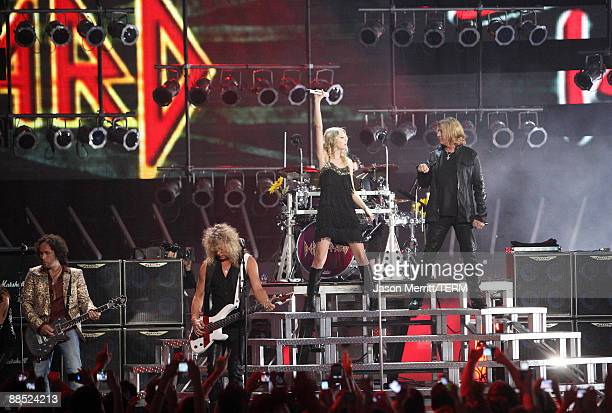Musician/singers Taylor Swift and Joe Elliot of Def Leppard on stage during the 2009 CMT Music Awards at the Sommet Center on June 16, 2009 in...